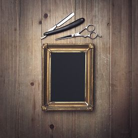 stock photo of barber razor  - Picture Frame And Vintage Barber Tools on the wood - JPG