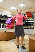 Woman With Shopping Bags At  Shoe Store