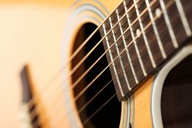 image of string instrument  - Classic acoustic guitar at weird and unusual perspective closeup - JPG