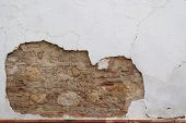 Stone wall with peeling plaster