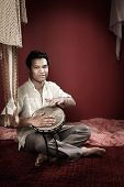 Indian Man Plays A Tabla