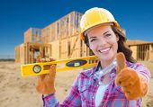 Female Construction Worker with Thumbs Up Holding Level Wearing Gloves, Hard Hat and Protective Gogg poster