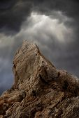 Rock In Stormy Clouds
