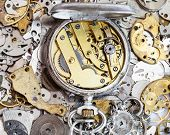 Open Used Pocket Watch On Pile Of Spare Parts poster
