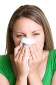 image of blowing nose  - Beautiful sick woman blowing nose wearing green - JPG