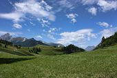 pic of engadine  - Summer rural landscape with a castle on a hill in the middle of the Swiss mountains near the border of natural park Engadin - JPG