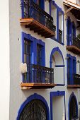 image of taxco  - Blue balconies in beautiful silver town of Taxco Mexico - JPG