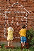Two Kids Drawing A Home