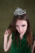 stock photo of fidget  - Caucasian woman with tiara plays with her hair - JPG