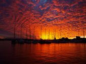 Striking Blood Red Sunset Over Sailboats In An Australian Marina.