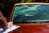 Insurance Agent Estimates The Cost Of Damaged Windshield After Car Accident, poster