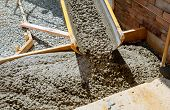 Pouring Cement During Paving Concrete Pavement Near The Driveway poster