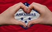 Over American State Flag Of Arkansas Showed Heart And Love Gesture Made By Hands