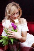 Beautiful young woman with tulips