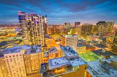 Denver, Colorado, USA downtown cityscape rooftop view at dusk.  poster