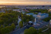 Beautiful Sunset View Over Riga By The Statue Of Liberty - Milda In Latvia. The Monument Of Freedom. poster