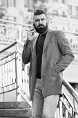 Stay In Touch. Man Bearded Serious Businessman Hold Mobile Phone Urban Background. Hipster Smartphon poster