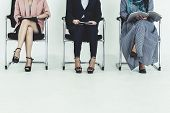 Business People Job Applicants Sitting And Waiting On Chairs In Office. Job Application And Recruitm poster