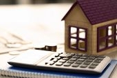 Home Coins Real Estate Property Loan Sale Concept. House, Calculator. Bank Credit For Residential Pu poster