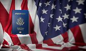 USA passport on the flag of the US United Stetes. Getting a USA passport,  naturalization and immigr poster