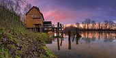 A watermill with reflection in the countryside - sunset Slovakia - Jelka Panoramic view