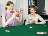 Girl And Grandma Playing Cards