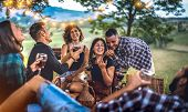 Young Friends Having Fun At Vineyard After Sunset - Happy People Millennial Camping At Open Air Pic  poster