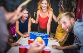 Young Friends Playing Beer Pong At Youth Hostel - Free Time Travel Concept With Backpackers Having U poster