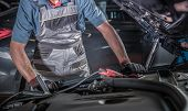 Car Battery And Alternator Problem. Caucasian Automotive Mechanic Trying To Find Source Of The Probl poster