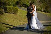Newlyweds Embracing On A Winding Path