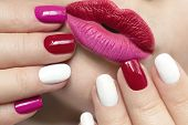 Fashionable Glamorous Manicure And Lip Makeup With Red Pink Lipstick And Multi-colored Nail Design W poster