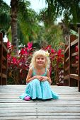 Portrait of a beautiful little girl with plumeria