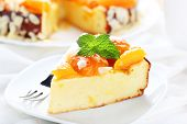 stock photo of fancy cakes  - A piece of cake with apricot and almonds - JPG
