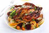 Whole roasted chicken with vegetables