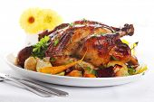 pic of roast chicken  - Whole roasted chicken with vegetables on a white plate - JPG