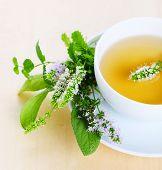cup of herbal tea and edible flowers