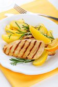Chicken with fresh rosemary and baked apple
