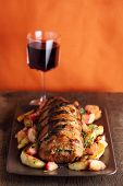 stock photo of roasted pork  - Roast pork with sage and thyme sauteed potatoes and spiced apple sauce - JPG