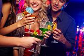 Young people spending time in nightclub celebrating birthday