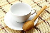 White cup with wooden spoon