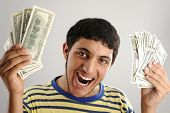 Young man holding money dollars