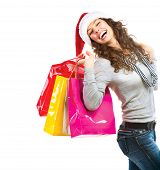 Happy Fashion Woman with Shopping Bags. Sales. Christmas Gifts. Christmas Shopping Girl Isolated on