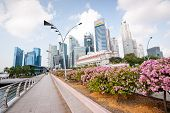 Singapore - April 23:�a Road Leads Into The Commercial Center Of Singapore. Singapore Has A Highly