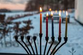 stock photo of menorah  - Beautiful Hanukkah menorah chanukkiah with glowing candles in a window - JPG