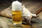 Glass With Beer And Dried Fish.