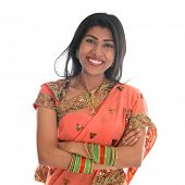 Portrait of beautiful traditional Indian woman in sari dress smiling, isolated over white background