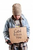 stock photo of scourge  - homeless person selective focus on face and cardboard - JPG
