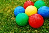 Vibrant Multi Coloured Balls On Grass