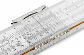 Close-up of slide rule isolated on white