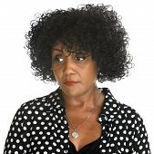 stock photo of sulky  - Serious African woman in polka dots looking over - JPG